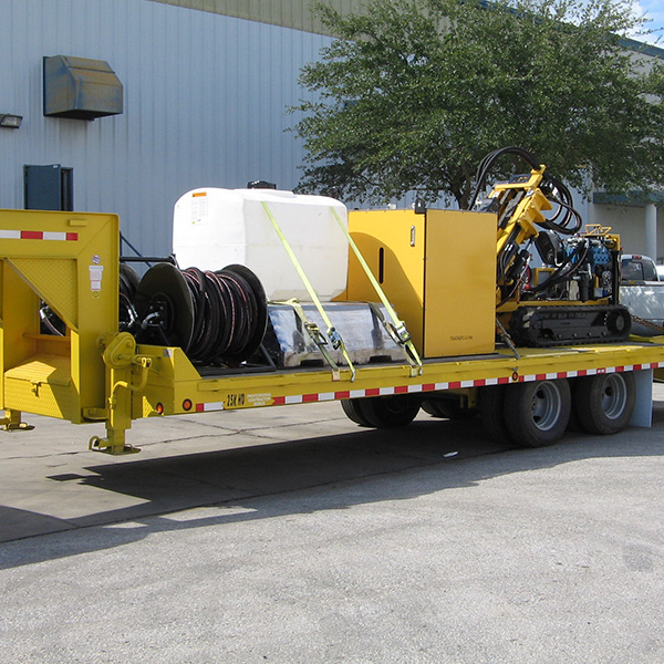 Trailer with hydraulic hose system, drilling pipe, diesel engine and the CGR-174U drill rig.